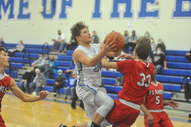 Mansfield Christian's Colin Comstock draws a charge against Crestline's Calvin Reed.