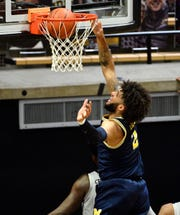 Michigan's Isaiah Livers makes a layup during the first half against Purdue at Mackey Arena in West Lafayette, Ind., Friday, Jan. 22, 2021.