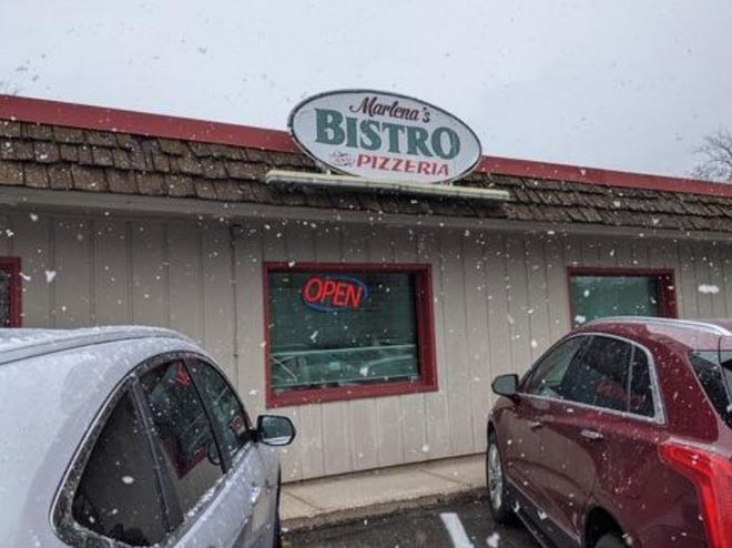 Marlena's Bistro and Pizzeria in Holland has remained open throughout the state-wide dine-in ban. A state agency suspended the restaurant's food establishment license Thursday.