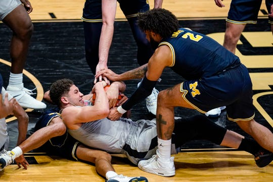 Purdue forward Mason Gillis and Michigan forward Isaiah Livers try to get possession of the ball during the second half in West Lafayette, Ind., Friday, Jan. 22, 2021.