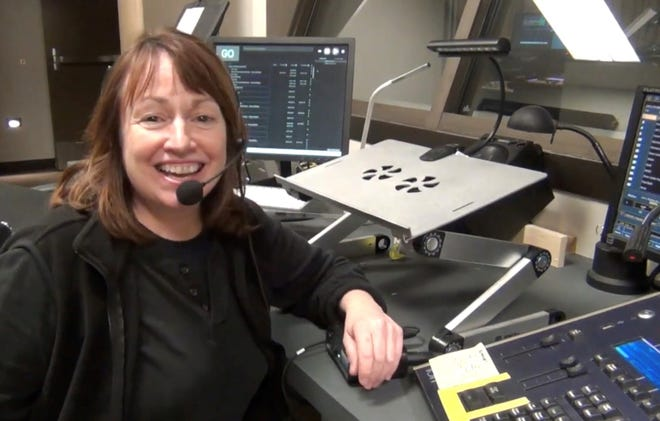 Neen Rock smiles from the tech booth at Northern Sky Theater's new Gould Theater in Fish Creek, which opened in August 2019. Rock, who served as production stage manager for the company from 1999 until her death Jan. 3, is remembered for her multiple backstage talents, efficiency and kindness during her more than 30 years with the company.