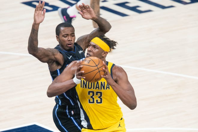 Indiana Pacers center Myles Turner (33) goes up to shoot the ball while Orlando Magic forward James Ennis III (11) defends in the third quarter at Bankers Life Fieldhouse.