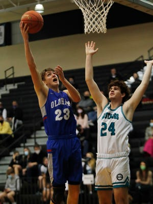 Oldham County's Xander Wagner-Rose gets the basket over North Oldham's Will Yochum.