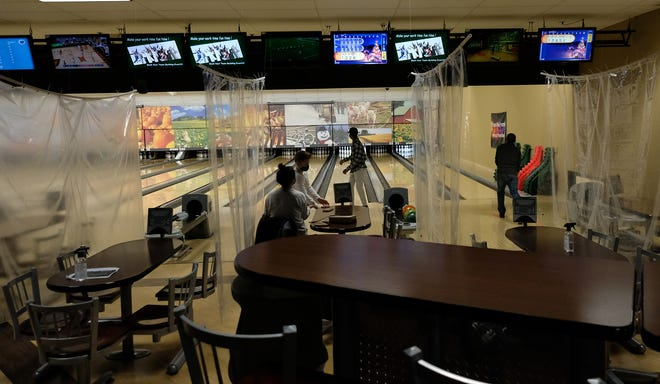The Spare Time Entertainment Center has long plastic sheets to separate the lanes Saturday, Jan. 21, 2021.