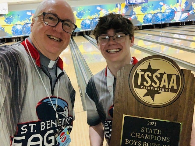 St. Benedict bowling coach and Deacon Jeff Drzycimski (left) and senior captain Riley Martin celebrates Saturday's TSSAA Division II state championship in Smyrna. The Eagles defeated Pope John Paul II, 16-11.
