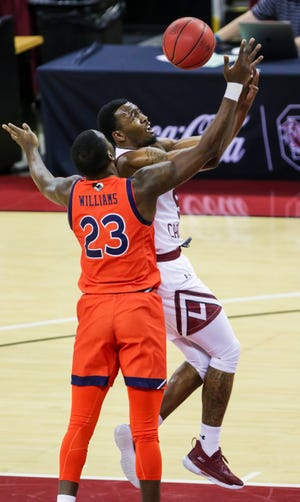 Jan 23, 2021; Columbia, South Carolina, USA; South Carolina Gamecocks guard Jermaine Couisnard (5) loses the ball driving past Auburn Tigers forward Jaylin Williams (23) in the first half at Colonial Life Arena. Mandatory Credit: Jeff Blake-USA TODAY Sports