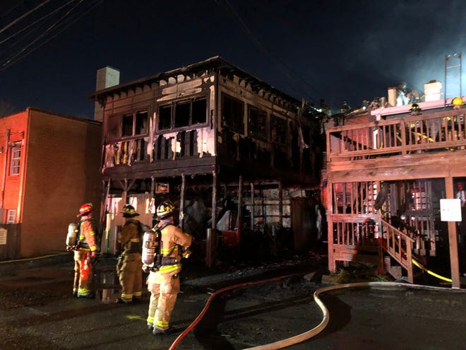 Crews from the Franklin fire department battle a blaze at the Red Pony restaurant on Main Street.