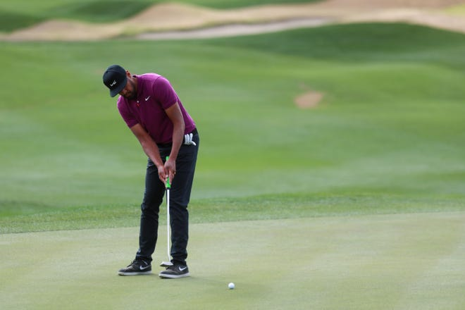 Tony Finau putts on the 1st green on the PGA West Pete Dye Stadium Course during the third round of The American Express in La Quinta, Calif., on January 23, 2021.