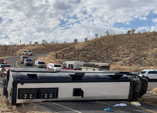 A tour bus heading to Grand Canyon West rolled and landed on its side near Dolan Springs on Jan. 22, 2021.