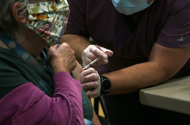 Washoe County School District employees receive the COVID-19 vaccine at North Valleys High School in Reno on Jan. 23, 2021.