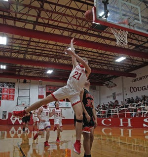 Christoval's Jaron Slaton (21), center, lays the ball in to the hoop during a game against McCamey on Friday, Jan. 22, 2021.