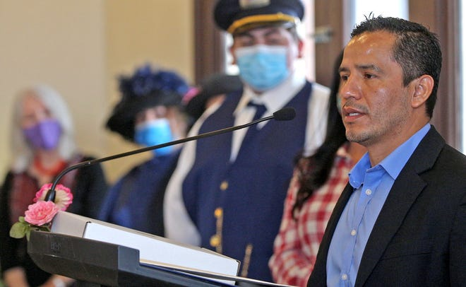 Ricardo Gutierrez, far right, speaks during an event honoring his late father, Gregorio Gutierrez, at the Railway Museum of San Angelo on Saturday, Jan. 23, 2021.