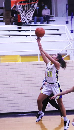 Ozona High School's Reaghan Gonzalez lays the ball up for a basket during a District 7-2A girls basketball game Tuesday, Jan. 19 2021, in Ozona.