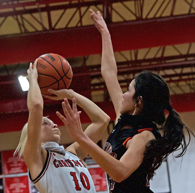 Christoval's Allison Vaughn (10), left, puts up a shot during a game against McCamey on Friday, Jan. 22, 2021.