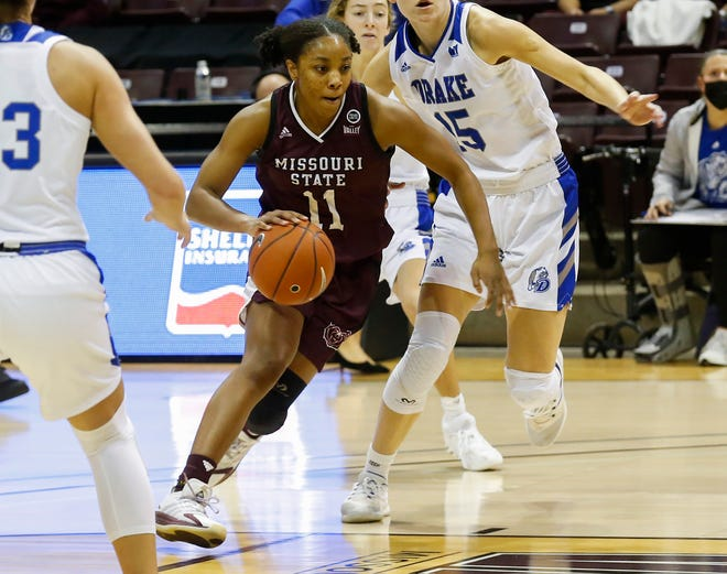 Brice Calip, of Missouri State, drives to the net during the Lady Bears game against Drake on Saturday, Jan. 23, 2021.