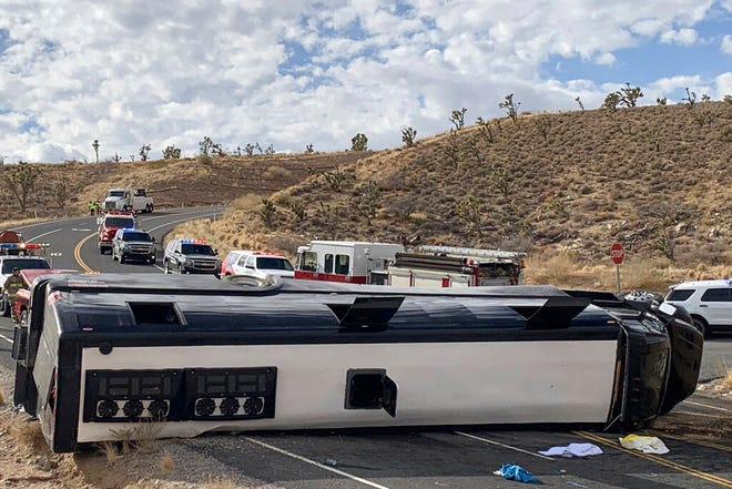 This photo provided by the Mohave County Sheriff's Office shows a Las Vegas-based tour that rolled over in northwestern Arizona on Friday, Jan. 22, 2021. One person died, and two were critically injured. The cause of the rollover is under investigation. (Mohave County Sheriff's Office via AP)