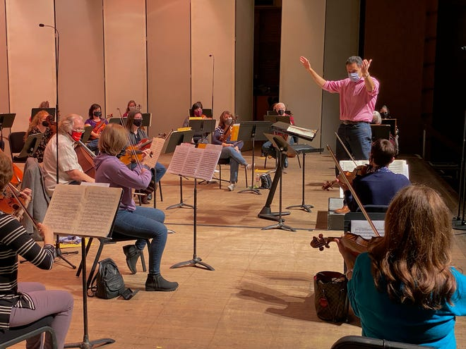 Conductor Fouad Fakhouri rehearsing with a socially distanced and masked 34 member Wichita Falls Symphony Orchestra string group in preparation for its first performance since Feb 2020. They will perform three string pieces that will be videoed. Listeners can purchase tickets for $10 to experience the performance online starting January 30 until February 20. The digital link can be purchased from www.WFSO.org or by calling (940) 723-6202, and the link will be emailed.