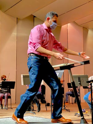 Conductor Fouad Fakhouri rehearsing with a socially distanced and masked 34-member Wichita Falls Symphony Orchestra. The WFSO string group performance will be professionally recorded and will feature up-close shots of the musicians and conductor.