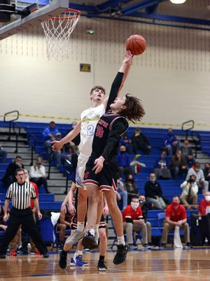 Coshocton's Abe Jarvis goes up for a shot in the lane over Maysville's Quentin Stottsberry during a 57-52 loss on Jan. 22 in Newton Township.