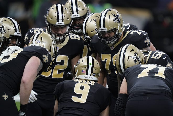 New Orleans Saints quarterback Drew Brees calls a play in the huddle during the Jan. 17 NFC division playoff game loss to the Tampa Bay Buccaneers. Might that have been the future Hall of Famer's final game?