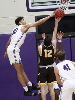 Mount Union's Braedon Poole (left) blocks a shot by Baldwin Wallace's Shane Zalba during Saturday's game at Mount Union.