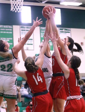 West Branch and Minerva players vie for a rebound during action at West Branch High School Saturday, January 23, 2021.