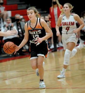 Marlington's Elizabeth Mason runs a fast break as Salem's Casey Johnson pursues in an Eastern Buckeye Conference game at Salem High School Saturday, January 23, 2021.