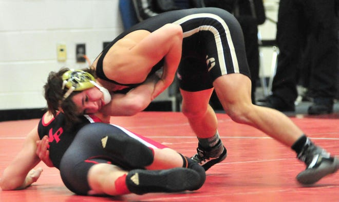 South Central's Jayden Strickland competes at the Dave Rohr Classic on Saturday at Mapleton High School. Strickland took first place at 132 pounds.