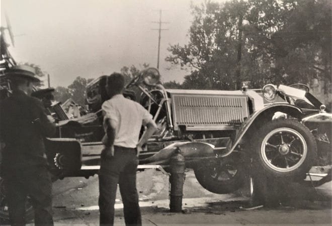 The wreck of a city fire truck in the early 1930s.