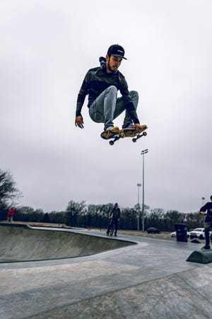 Dreary weather doesn't stop Josh Petermann from catching some air at a Bartlesville skatepark on Sunday, Jan. 24.