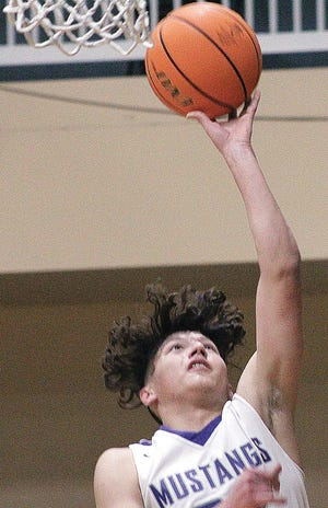 Wesleyan Christian School's Kade Kelley rings up a layup during Friday's 72-22 home win against Bluejacket.