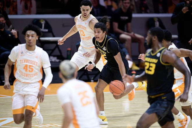 Missouri guard Dru Smith (12) dribbles against Tennessee during a game Saturday night at Thompson-Boling Arena in Knoxville, Tenn.
