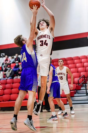 Sophomore forward Cayden Potter of the 2020-21 Chillicothe High School basketball Hornets, seen scoring from close range against Hamilton Jan. 12, tallied 10 points and grabbed five rebounds in lastSaturday's 68-51 victory over host Camdenton. That continues a recent run of strong play by Potter after he recovered from a health issue. ( BUTCH SHAFFER / C-T FILE PHOTO )