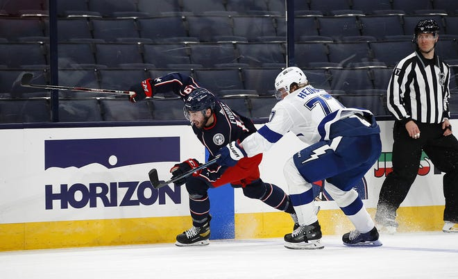 Blue Jackets rookie Liam Foudy (19) uses his speed to get around Tampa Bay defenseman Victor Hedman in the third period of Saturday's win.