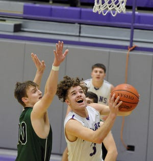 Triway's Channer Wells drives to the hoop around Smithville's Luke Meech during Triway's 65-58 win on Saturday.