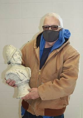 DCCC graduate Jim Reneau donated a conquistador bust sculpture to DCCC recently.