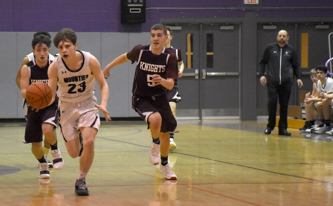 Little Falls varsity basketball and football coach Bryan Shepardson (far right) watches since-graduated Mountie Devon Callahan (23) run the floor during the first half of a Feb. 13, 2020, home basketball game against Frankfort-Schuyler. Shepardson could be starting basketball practice next week with a potential football season one month away, pending guidance from the Herkimer County Health Department.