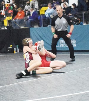 Mount Pleasant High School junior Abby Blint (left) pins Jada Daily of Davenport West in 40 seconds to take seventh place at 106 pounds Saturday at the IWCOA Girls State Tournament in Coralville.