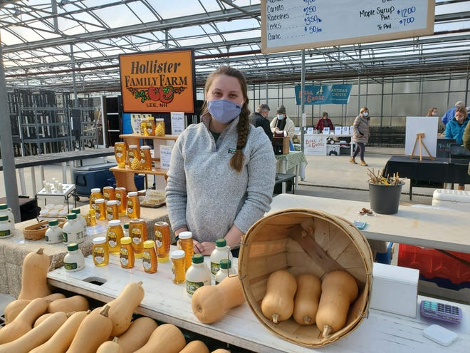 Stephanie Hollister, of Hollister Family Farms in Lee, offers gourds and farm fresh honey during the Seacoast winter farmers market Wentworth Greenhouses in Rollinsford Saturday, Jan. 23, 2021.