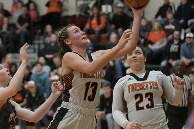 Macon guard Lexi Miller drives to the basket for a layup Saturday against Mexico.