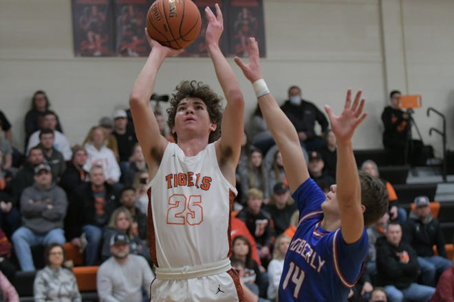 Kirksville sophomore Keaton Anderson puts up a jumper for two points during the first half of Saturday's Macon Tournament title game against Moberly.