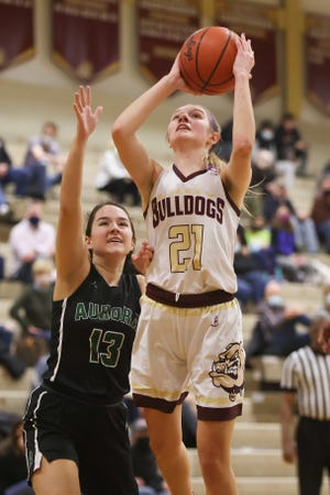 Stow senior Lilee Carlson goes up for a shot while Aurora freshman Kailey Feckner defends during Saturday night's game, January 23, 2021 at Stow-Munroe Falls High School.