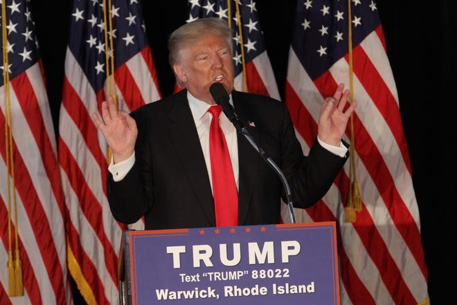 Then-presidential candidate Donald Trump takes the stage at the Crowne Plaza in Warwick during a campaign stop in Rhode Island in April 2016. Trump's populist style won over many Rhode Island working-class voters.