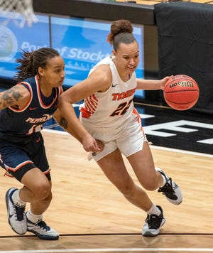 University of the Pacific's Valerie Higgins drives past Pepperdine's Jayla Ruffus-Milner in a game in January. Higgins last week became the first female Pacific basketball player ever to be tapped by the WNBA.