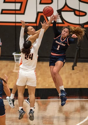20210123.    University of the Pacific women's basketball team hosts Pepperdine in the Spanos Center  Saturday Jan 23, 2021.Pacific's Lianna Tillman, in back and Liz Smith defend against Pepperdine's Malia Bambrick.