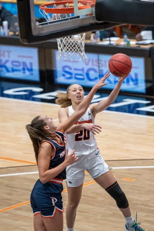 University of the Pacific's Erica Adams lays the ball in on a fast break after a steal against Pepperdine's Monique Andriuolo during a home game Saturday in the Spanos Center.