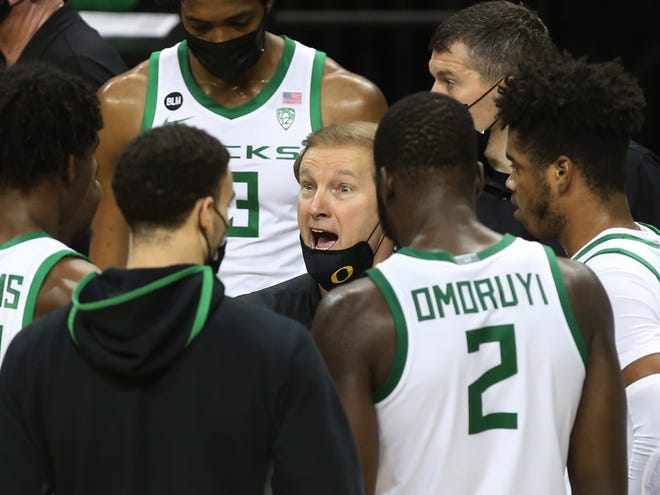 Oregon coach Dana Altman tries to collect his team as they trail Oregon State during the first half.