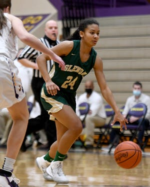 GlenOak's Breezie Williams handles the basketball during a Jan. 23, 2021 game at Jackson.