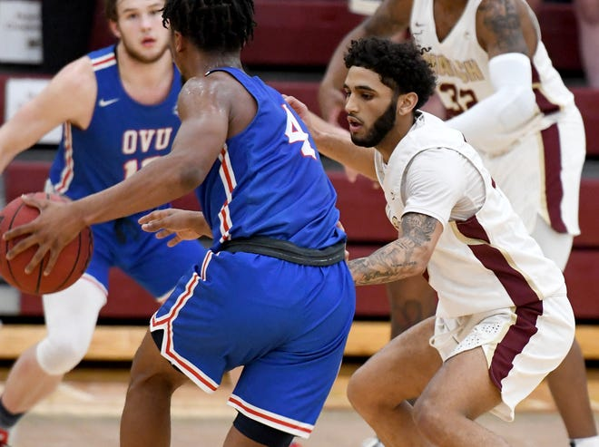 Walsh's Kaleb Martin guards Ohio Valley's Cameron Shaw in the second half of Ohio Valley at Walsh Mens Basketball. Saturday, January 23, 2021.