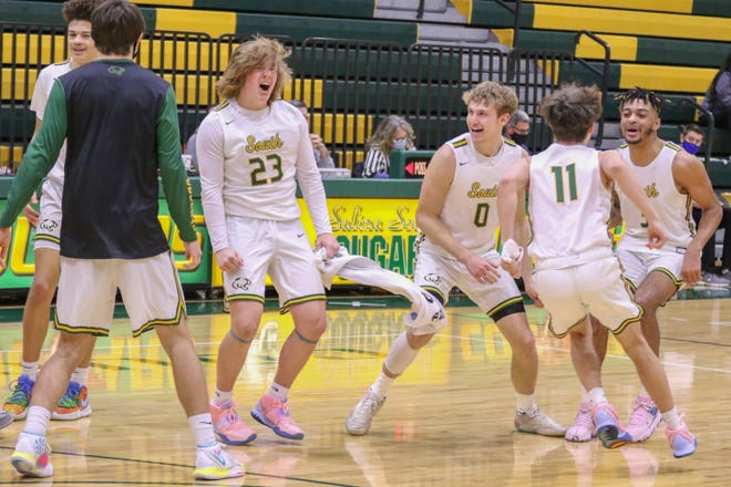 The Salina South Cougar celebrate after beating the Andover Trojans on Saturday in the SIT Championship.
